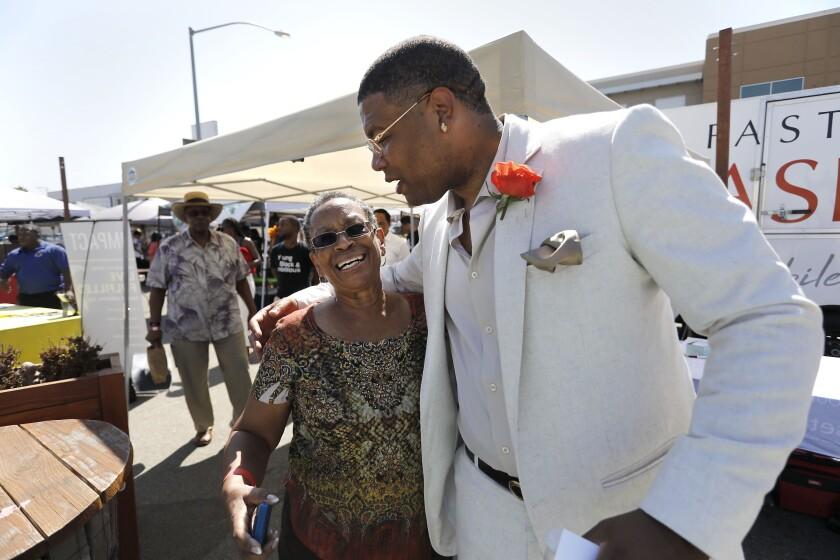 Renee Steele gets a hug from Roosevelt Williams III