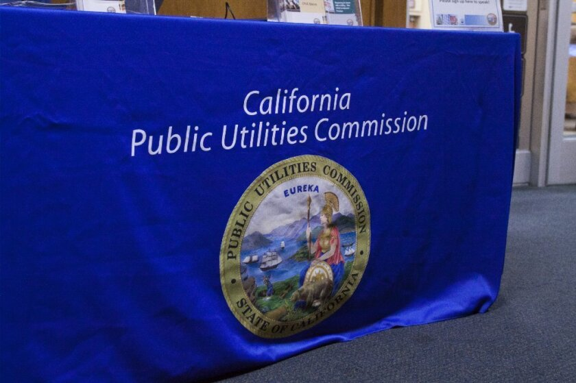 The California Public Utilities Commission logo on a table outside of the Council Chamber. - Chadd Cady / San Diego Union-Tribune