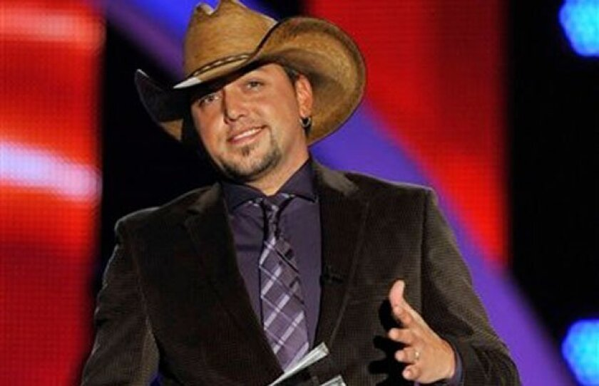 Jason Aldean is honored at the CMT Artists of the Year television taping in Franklin, Tenn., on Tuesday, Nov. 30, 2010. (AP Photo/Donn Jones)