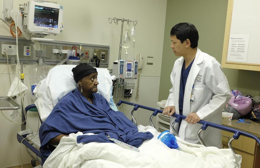 Dr. Ted Chan checks on a patient at Thornton Hospital's emergency department. A shift toward more outpatient care is trending.