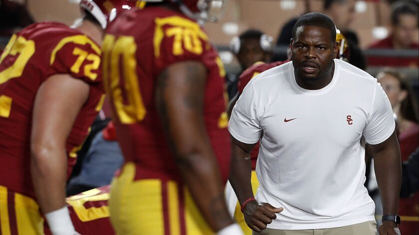 LOS ANGELES, CALIF. - OCT. 13, 2018. USC assistant coach Kenechi Udeze gets the Trojans fired upo f