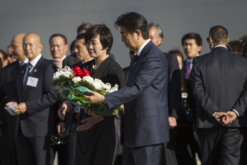 Japanese Prime Minister Shinzo Abe, with his wife Akie Abe, lays a wreath at Little Tokyo's Go For Broke monument, which honors Japanese American soldiers who served in World War II.