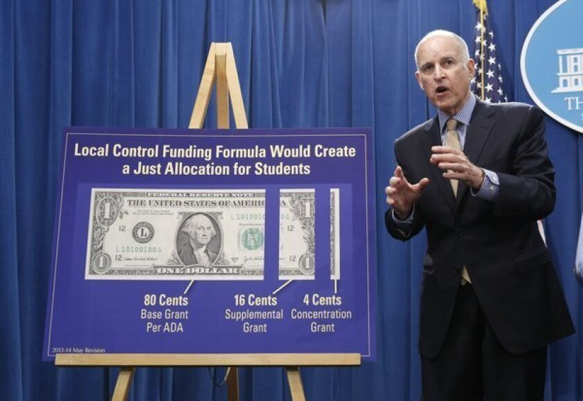 Gov. Jerry Brown talks about his plan for education funding at a news conference in Sacramento.