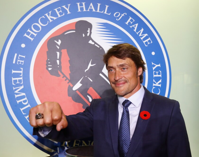 Teemu Selanne poses for photos at the Hockey Hall Of Fame and Museum on Nov. 10, 2017, in Toronto.
