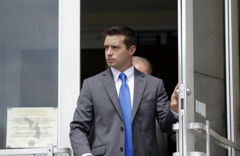 In a Wednesday, Sept. 9, 2015 file photo, former Madison, Ala., police officer Eric Sloan Parker walks out of the federal courthouse, in Huntsville, Ala.  A second jury deadlocked Wednesday, Nov. 4, 2015, and a judge declared another mistrial Wednesday in the case of Parker, charged with using exce