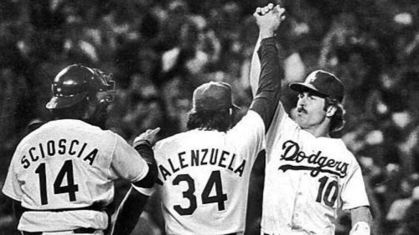 Oct. 23, 1981: Dodgers' pitcher Fernando Valezula , no. 34, is congratulated by teammates Mike Sci