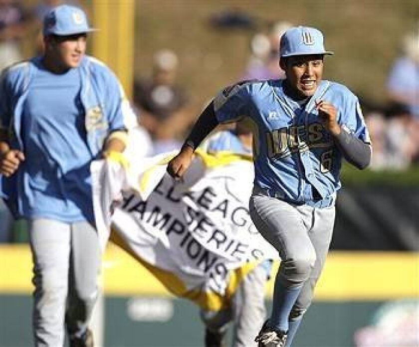 Andy Rios and teammates run a victory lap after Park View LIttle League won the Little League World Series championship baseball game, beating Taiwan 6-3.