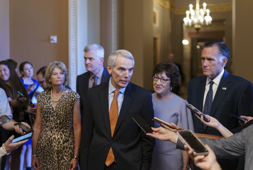 Sen. Rob Portman, R-Ohio, center, joined by, from left, Sen. Lisa Murkowski, R-Alaska, Sen. Bill Cassidy, R-La., Sen. Susan Collins, R-Maine, and Sen. Mitt Romney, R-Utah, announces to reporters that he and the other GOP negotiators have reached agreement on a $1 trillion infrastructure bill with Democrats and are ready to vote to take up the bill, at the Capitol in Washington, Wednesday, July 28, 2021. (AP Photo/J. Scott Applewhite)