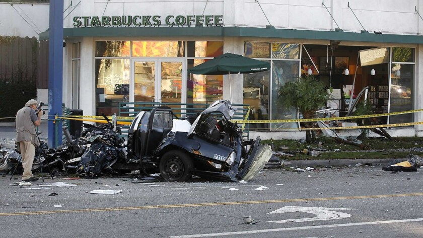 Nicholas Bowling stole an LAPD cruiser on Aug. 31, 2012, and smashed it into a Starbucks and a light pole in the Mid-Wilshire neighborhood.