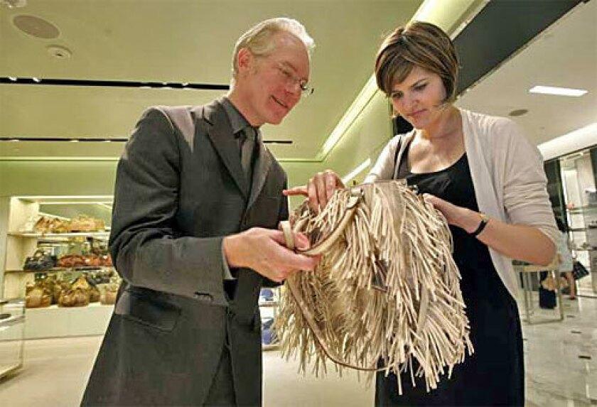 'COUSIN ITT': Gunn and co-author Kate Moloney examine a fringed Prada.