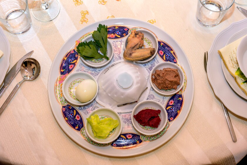 Seder plate with an N95 mask in the middle