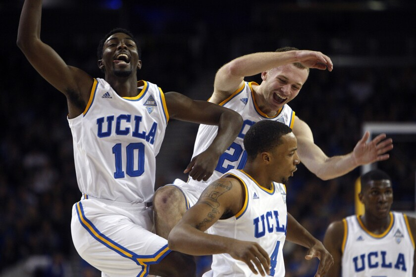 UCLA players Isaac Hamilton (10), Bruce Alford (20) and Norman Powell (4) celebrate a basket in the first half of an 85-74 win against USC.