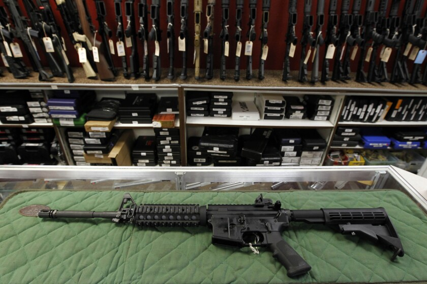 An AR-15-style rifle is displayed at an indoor range and gun shop in Colorado in 2012.