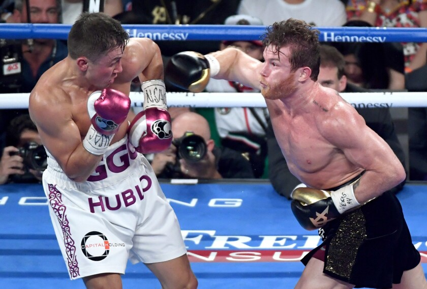 Canelo Alvarez (R) throws a right at Gennady Golovkin in the third round of their WBC/WBA middleweight title fight at T-Mobile Arena on September 15, 2018 in Las Vegas, Nevada. Alvarez won by majority decision.