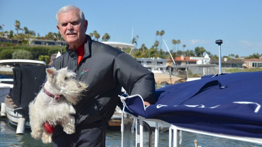 Tim Mang, recently inducted into the National High School Tennis Coaches Assn. Hall of Fame, often takes his faithful companion, Chelsea, along for boat rides in Newport Harbor.