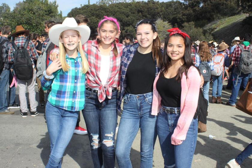 Annie Peppers, Esra Yazici, Samantha Ponticello and Sophie Hochberg attend Muirlands Middle School's Western BBQ on Dec. 20, 2018.