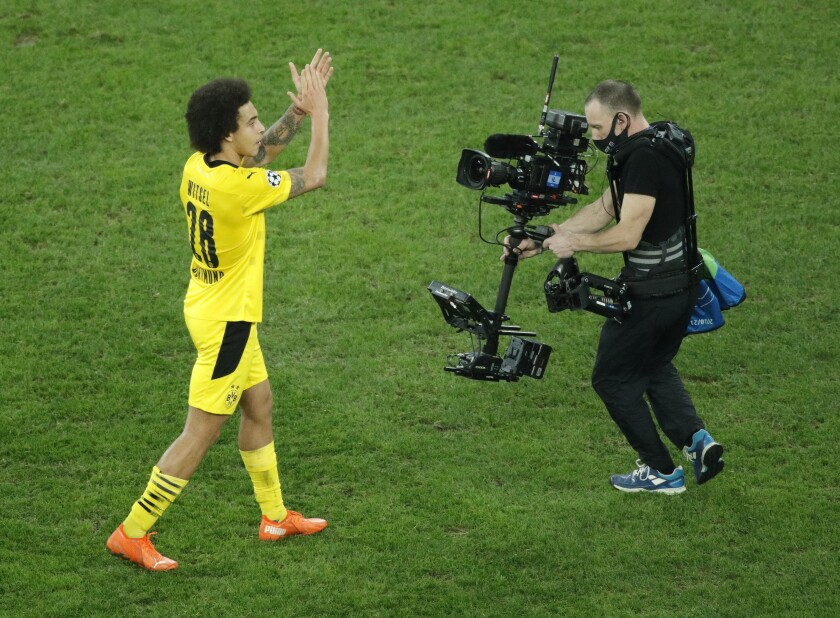 Dortmund's Axel Witsel, left, celebrates as his team won the Champions League group F soccer match between Zenit St.Petersburg and Borussia Dortmund at the Saint Petersburg stadium in St. Petersburg, Russia, Tuesday, Dec. 8, 2020. (AP Photo/Dmitri Lovetsky)