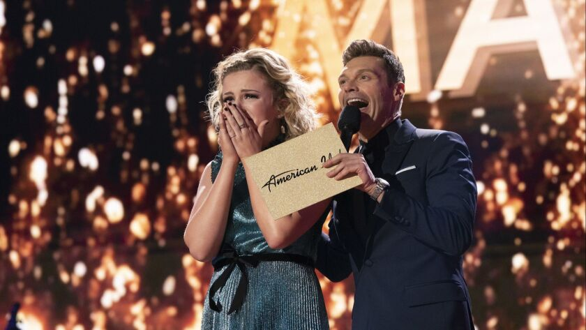 In this May 21, 2018 photo provided by ABC, Maddie Poppe, left, reacts with Ryan Seacrest after bein