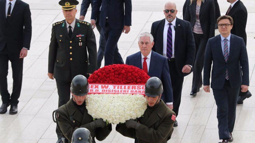 U.S. Secretary of State Rex Tillerson, center, attends a wreath-laying ceremony at Anitkabir, the mausoleum of Turkey's modern founder, Mustafa Kemal Ataturk, in Ankara.