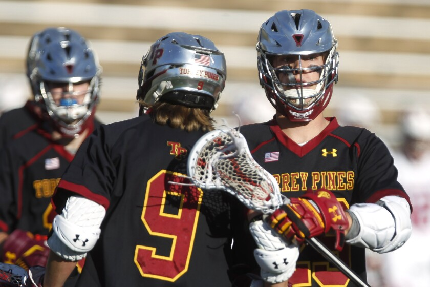 Torrey Pines' Alex Pistorius (right, in an earlier match this season) scored three goals in the Falcons' win over La Costa Canyon on Saturday.