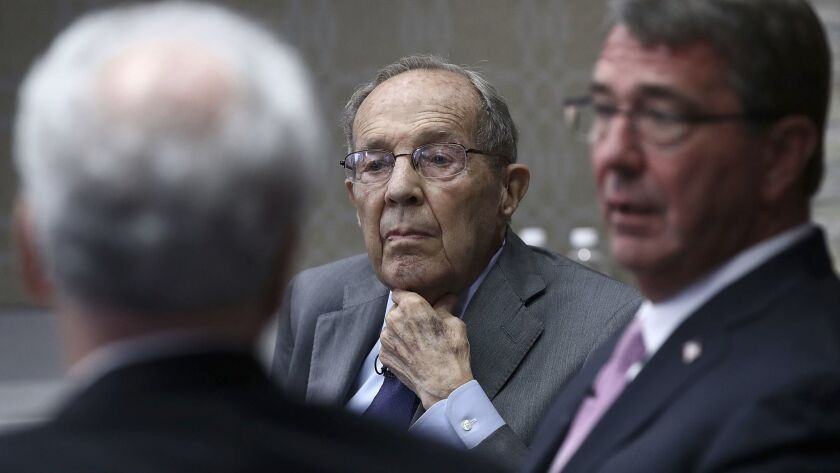 Former U.S. Defense Secretary William Perry, center, takes part in a discussion on the current polic