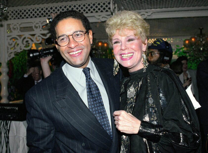 """FILE - In this Jan. 13, 1992 file photo, NBC's """"Today"""" show co-anchor Bryant Gumbel, left, and former member of the morning television show Betsy Palmer pose at the 40th anniversary party for the show in New York City. Palmer, the actress whose long film, stage and television career began in 1951 in the early days of live television and who later found a new generation of fans in her role as Mrs. Vorhees in the cult film classic Friday the 13th, has died at the age of 88, it was announced today by her longtime manager Brad Lemack. Lemack reports that Palmer died of natural causes on May 29, 2015, at a hospice care center near her Danbury, Conn., home.(AP Photo/Mark Lennihan, File)"""