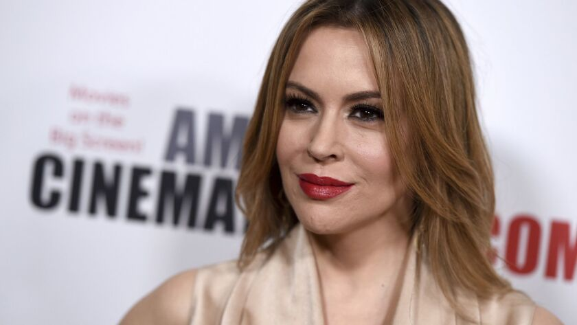 Actress Alyssa Milano wrote an op-ed following her controvresial tweet that compared red Make America Great Again hats to white hoods.