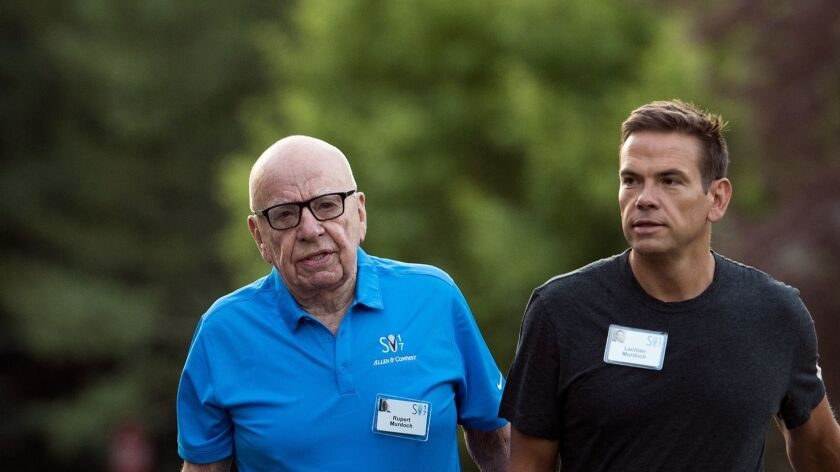 Rupert Murdoch, executive chairman of 21st Century Fox, and his son Lachlan Murdoch, who will become chairman and CEO of Fox following the sale of key assets to Disney.