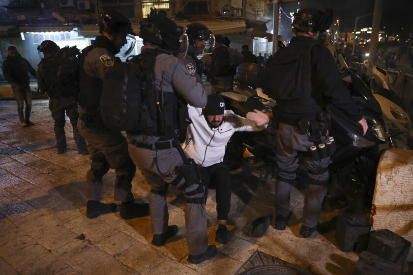 Israeli riot police detain a Palestinian man during clashes near Damascus Gate just outside Jerusalem's Old City, Thursday, April. 22, 2021. Palestinians clashed with Israeli police over restrictions on Ramadan gatherings ahead of a planned march by Lahava, a Jewish extremist group, to the area later on Thursday amid heightened tensions in the city. (AP Photo/Mahmoud Illean)