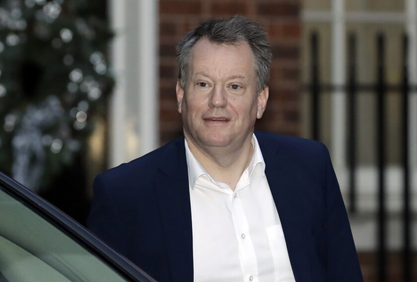 """FILE - In this Wednesday, Dec. 9, 2020 file photo, UK Chief Brexit negotiator David Frost leaves 10 Downing Street, in London. Britain's Brexit minister predicted Monday, May 17, 2021 that relations between the U.K. and the European Union would continue to be """"bumpy,"""" amid tensions over post-Brexit trading arrangements. David Frost said talks with the EU on ironing out the problems were """"not hugely productive"""" so far. (AP Photo/Matt Dunham, File)"""