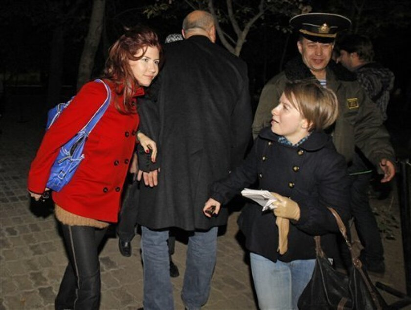 Anna Chapman, left, a Russian national who was deported from the U.S. this summer for alleged spying for Russia, with AP reporter Nataliya Vasilyeva at the farewell ceremony for a U.S. astronaut and two Russian cosmonauts at the Russian leased Baikonur cosmodrome, Kazakhstan, Thursday, Oct. 7, 2010. The three men are set to blast off to the International Space Station Friday morning. (AP Photo/Dmitry Lovetsky)