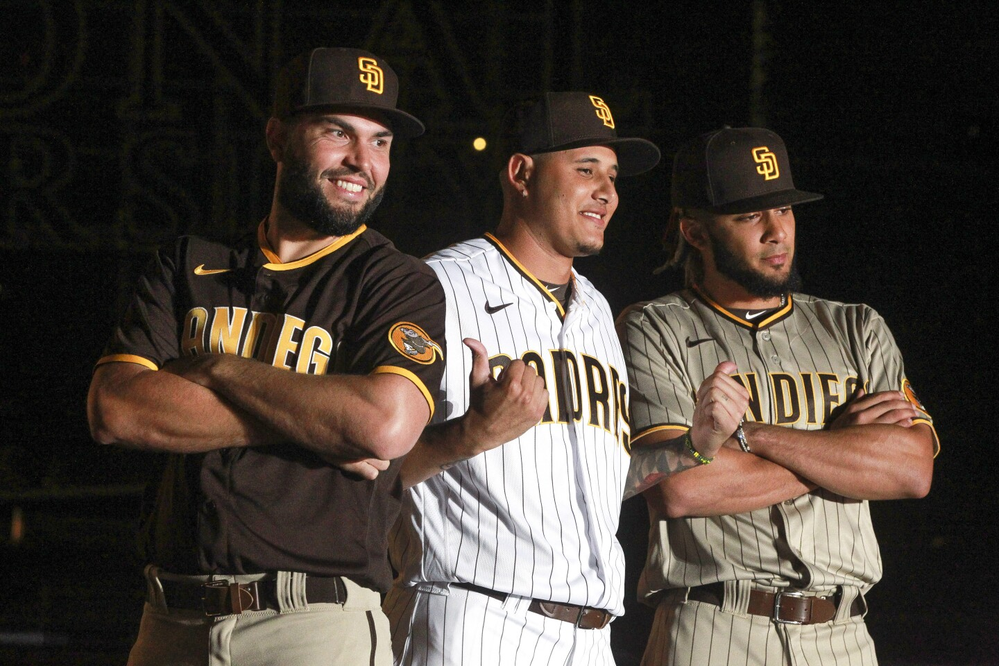 The Padres' Eric Hosmer, left, Manny Machado, center, and Fernando Tatis Jr. wear the Padres new uniforms during the Padres uniform unveiling event at Petco Park on Saturday, November 9, 2019 in San Diego, California.