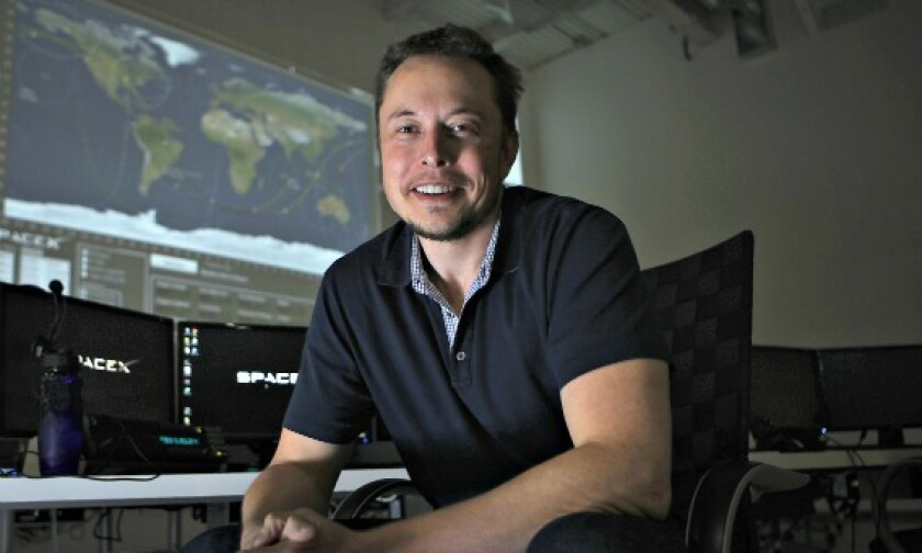 Elon Musk poses in the mission control room of Hawthorne-based SpaceX in April 2012.