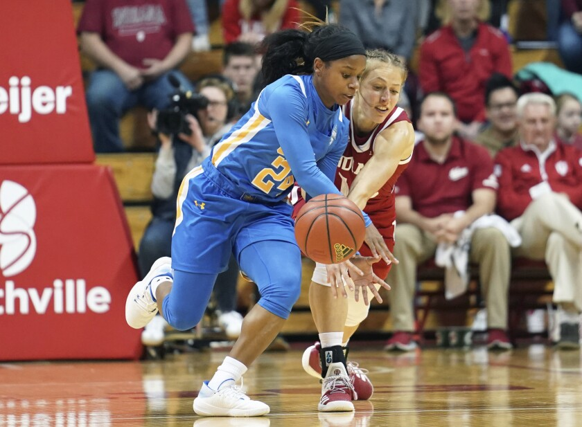 UCLA's Japreece Dean (24) steals the ball from Indiana's Ali Patberg (14) during the first half of a game Dec. 22 in Bloomington, Ind.