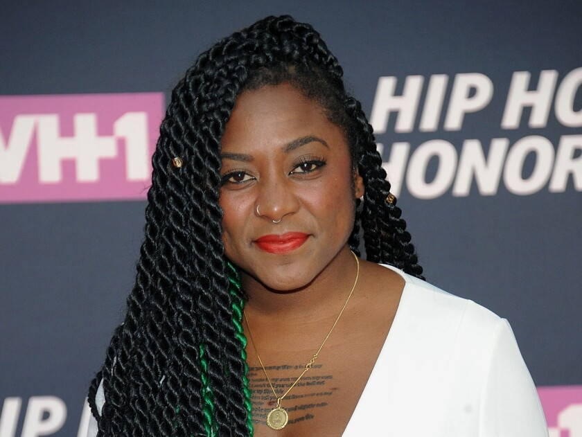 """FILE - In this July 11, 2016, file photo, co-founder of Black Lives Matter Alicia Garza attends the arrivals at VH1's Hip Hop Honors at David Geffen Hall at Lincoln Center in New York. Black activists believe the police killing of George Floyd and the nationwide civil unrest that followed could be the catalyst for overhauling the criminal justice system. """"What we're facing is a real reckoning on a lot of levels,"""" said Garza. """"This (coronavirus) pandemic pulled back the curtains on decades of disinvestment, decades of devaluing and also now one of the major issues that black communities face is violence at the hands of the police."""" (Photo by Brad Barket/Invision/AP, File)"""
