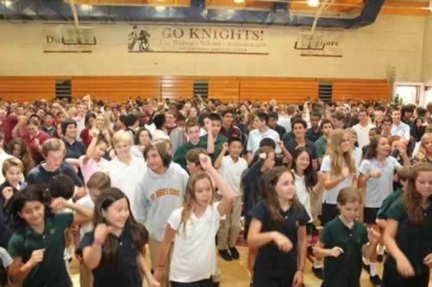 The Bishop's School student body filled the gym for a back-to-school assembly, where they learned different dances for the 'Dancing Through the Decades'-theme. here, they move to 'Jump Around' by House of Pain. Ashley Mackin