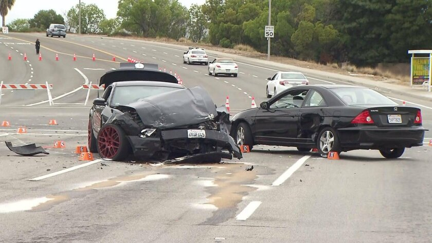 Two cars are pictured the morning after a fatal hit-and-run crash on June 10 in Irvine. (KTLA / June 17, 2015)
