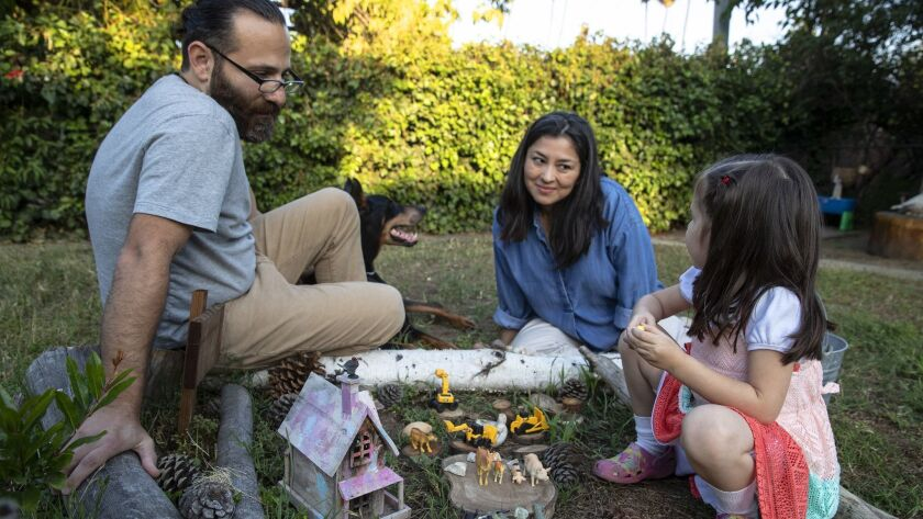Times reporter Esmeralda Bermudez at home with her husband David and 5-year old daughter in Los Angeles on June 7.