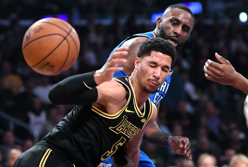 Lakers guard Josh Hart battles for a loose ball with Thunder forward Patrick Patterson during a game at Staples Center.