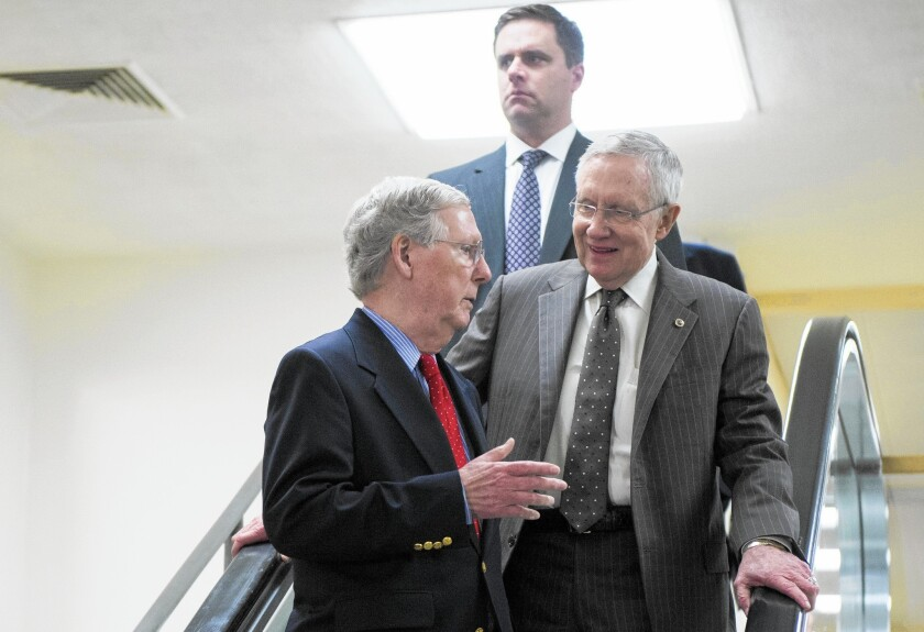 Sens. Mitch McConnell (R-Ky.), left, and Harry Reid (D-Nev.) chat on their way to a September briefing. McConnell will assume Reid's majority leader post after Tuesday's election.