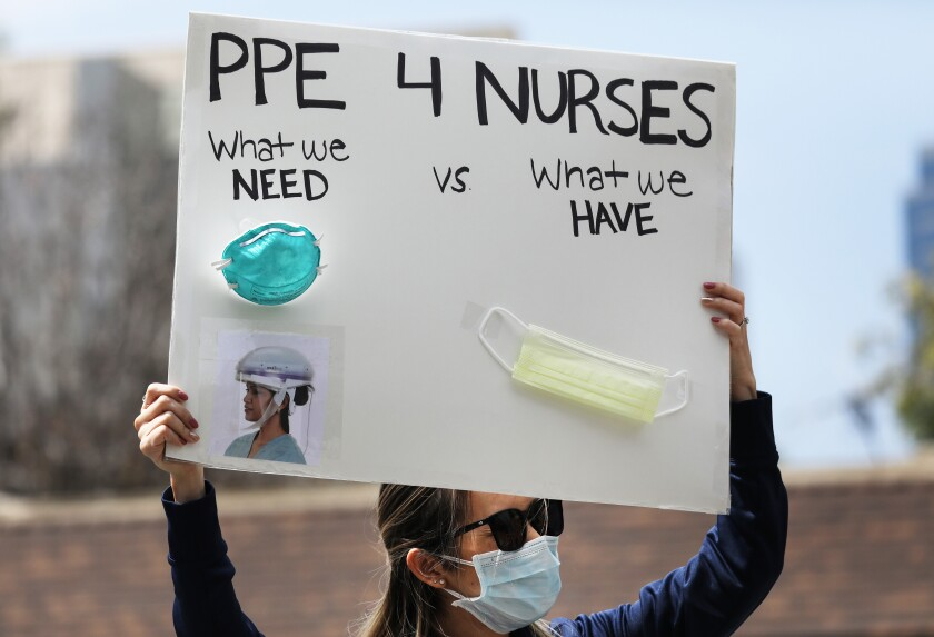 A nurse protests the lack of personal protective gear available at UCI Medical Center in Orange.