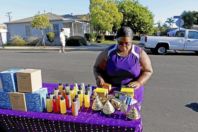 Jackie Lloyd sells body oils, shea butter, soap and incense after having been laid off from her job as an elementary school cafeteria worker four years ago.