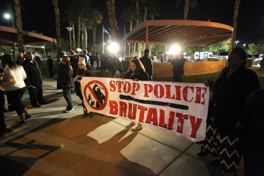 Protesters gather Nov. 24 at a Martin Luther King Jr. statue in North Las Vegas after a grand jury failed to indict a Ferguson, Mo., police officer in the fatal shooting of an unarmed black man. The decision spurred criticism and commentary abroad as well as in the United States.