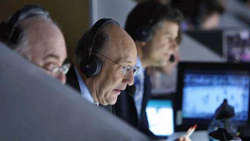 Kings play-by-play announcer Bob Miller, center, calls a game against the Edmonton Oilers at Staples Center on April 10, 2010.