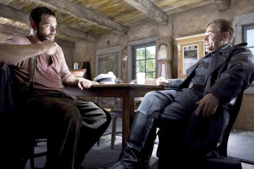 "Denis Ménochet and Christoph Waltz in the movie ""Inglourious Basterds."""