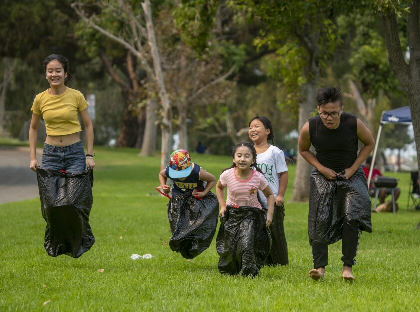 A family celebrates Labor Day with a sack race at Mile Square Park in Fountain Valley.