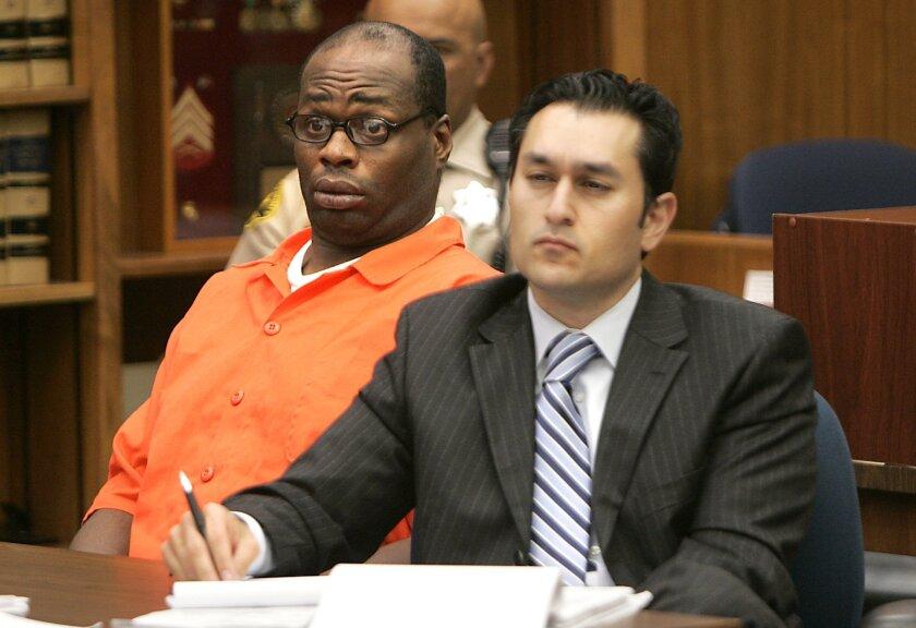 Defendant David Gates, left, listens to testimony in San Diego Superior Court June 27.