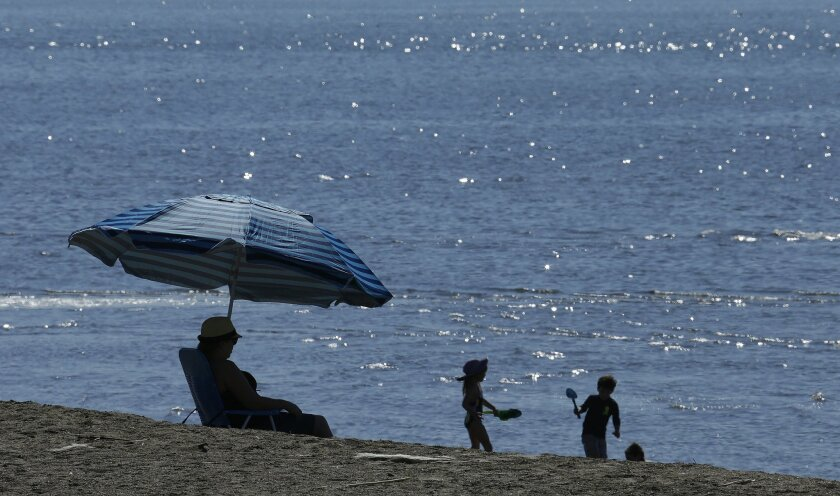 People enjoy unseasonably warm temperatures at Crown Beach Tuesday, Feb. 16, 2016, in Alameda, Calif. California is having another day of unseasonable warmth before a low-pressure system brings rain and snow. (AP Photo/Ben Margot)