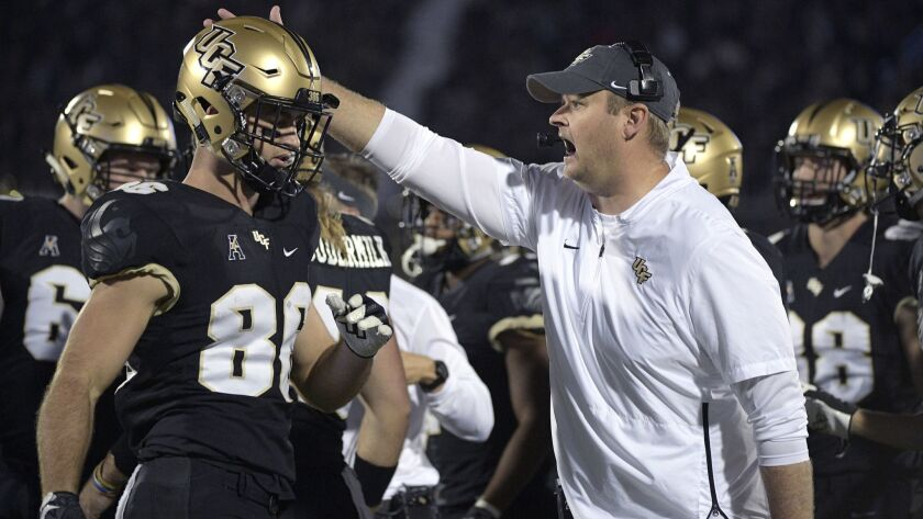 Central Florida head coach Josh Heupel calls out from the sideline during the first half of an NCAA