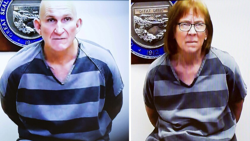 Blane Barksdale, left, and Susan Barksdale, right, are seen during a video arraignment in Pima County Superior Court, on Thursday, Sept. 19, 2019, Tucson, Ariz. The Barksdales, wanted in connection with a homicide in Tucson, had escaped custody during transport from upstate New York back to Tucson. They were recaptured on Sept. 11. (Rebecca Sasnett/Arizona Daily Star via AP, Pool)